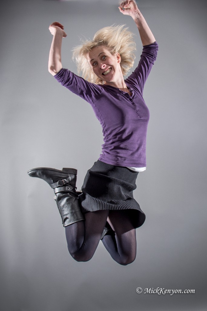 Girl jumping in the air in the photographic studio